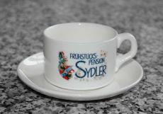 Kaffeetasse mit Untertasse und Löffel